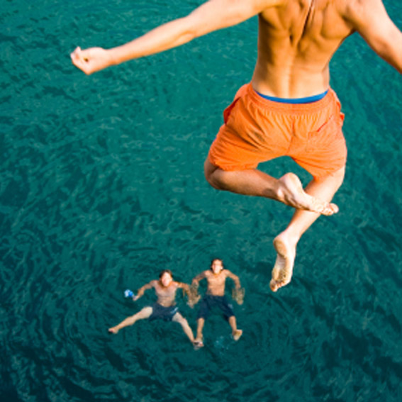 Cliff jumping into a lake